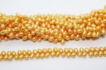 Herringbone Drilled Rice Freshwater Pearls - Orange - 6x8mm - A Grade