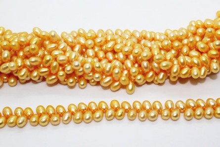 Herringbone Drilled Rice Freshwater Pearls - Orange - 6x8mm - A Grade